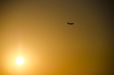 Avião e Pôr do Sol